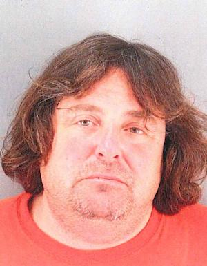 """In this May 10, 2013 booking photo provided by the San Francisco Police Dept. is Dan Sandler, who also goes by the name Adam Sandler.  Sandler, a homeless man with a history of playing an evil version of the """"Sesame Street"""" character Elmo from coast to coast was charged Wednesday June 5, 2013 in New York City with trying to extort $2 million from the Girl Scouts. Sandler, arraigned on attempted grand larceny and other charges, pleaded not guilty, and a judge ordered him held on $200,000 bail. Sandler, who was living in his car, was arrested in San Francisco last month on a warrant in the extortion case. (AP Photo/San Francisco Police Dept.)"""