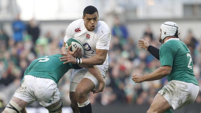 England's Luther Burrell, centre, is tackled by Ireland's Paul O'Connell, left, during their rugby union 6 nations match at the Aviva stadium, Dublin, Ireland, Sunday, March, 1, 2015.  (AP Photo/Peter Morrison)