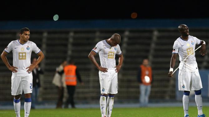 FC Porto's Carlos Eduardo, from Brazil, Ricardo Pereira and Eliaquim Mangala, from France, from left to right, react at the end of their Portuguese league soccer match with Belenenses Saturday, Nov. 2 2013, in Lisbon.  The game ended in a 1-1 draw