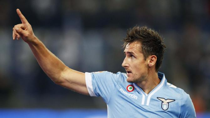 Lazio's Klose celebrates after scoring against Cagliari during their Italian Serie A soccer match at the Olympic stadium in Rome