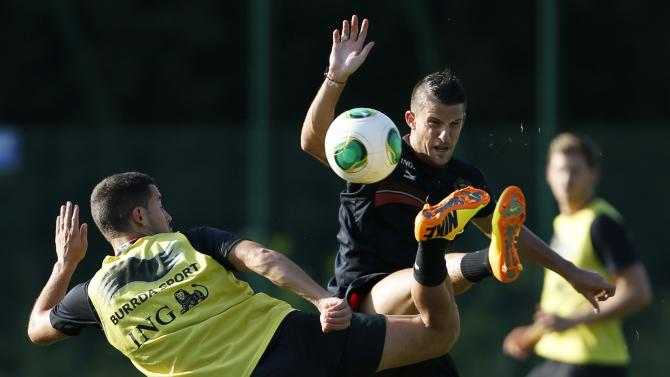 Belgian national soccer players Hazard fights for the ball with Mirallas during a training session in Brussels