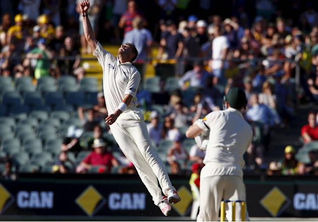New Zealand's Tim Southee jumps to stop a shot hit by Australia's Adam Voges during the third day of the third cricket test match at the Adelaide Oval, in South Australia