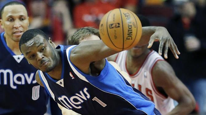Dallas Mavericks center Samuel Dalembert (1) controls the ball against Chicago Bulls guard Mike Dunleavy during the second half of an NBA basketball game in Chicago on Saturday, Dec. 28, 2013. The Mavericks won 105-83
