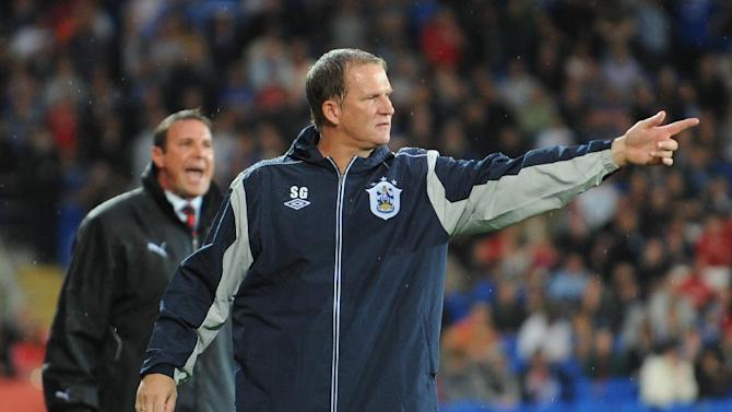 Huddersfield manager Simon Grayson has hinted he will add another striker to his squad