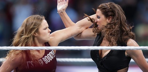 Ronda Rousey confronts Stephane McMahon at Wrestlemania XXXI, on Sunday, March 29, 2015 in Santa Clara, CA. 2015 marks the first year Wrestlemania will be held in the San Francisco Bay Area, being made available to viewers in 177 countries via the WWE Network. (Don Feria/AP Images for WWE)
