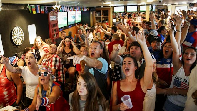 U.S. fans react as they watch the Women's World Cup final soccer match between USA and Japan, in Hermosa Beach, California