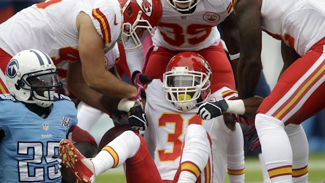 Kansas City Chiefs' Marcus Cooper (31) is helped up after recovering a fumble by the Tennessee Titans in the end zone for a touchdown in the first quarter of an NFL football game on Sunday, Oct. 6, 2013, in Nashville, Tenn. At left is Titans' Darius Reynaud (25)