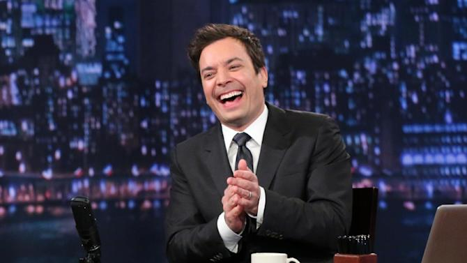 "This Feb. 21, 2013 photo released by NBC shows Jimmy Fallon, host of ""Late Night with Jimmy Fallon,"" on the set in New York. As Jay Leno lobs potshots at ratings-challenged NBC in his ""Tonight Show"" monologues, speculation is swirling the network is taking steps to replace the host with Jimmy Fallon next year and move the show from Burbank to New York.  NBC confirmed Wednesday, March 20, it's creating a new studio for Fallon in New York, where he hosts ""Late Night."" But the network did not comment on a report that the digs at its Rockefeller Plaza headquarters may become home to a transplanted, Fallon-hosted ""Tonight Show.""  (AP Photo/NBC, Lloyd Bishop)"