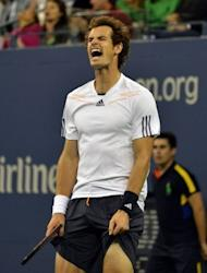 Andy Murray of Great Britain reacts against Novak Djokovic of Serbia during their 2012 US Open men's singles finals match in New York on September 10, 2012. Cheered on by fellow Scots Sir Sean Connery and Manchester United boss Sir Alex Ferguson, Murray survived a thrilling fightback by Djokovic