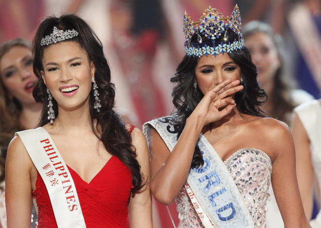 Miss Venezuela Ivian Sarcos reacts as she is crowned winner, Miss Philippines Gwendoline Ruais, left, was second at the Miss World competition held at Earls Court in London, Sunday, Nov. 6, 2011. (AP