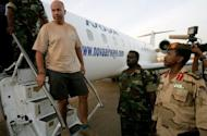 "One of four foreigners captured by Sudanese military in the Heglig oilfield area April 28, is escorted off an airplane in Khartoum. The British embassy was ""urgently"" investigating on Sunday the arrest in Sudan of one of its citizens, who was among four foreigners the Sudanese military said it captured in the tense Heglig oil region"