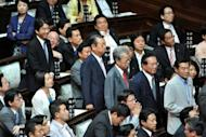 Former Democratic Party of Japan leader Ichiro Ozawa (C) attends a lower house plenary session of the National Diet, or parliament, in Tokyo on June 26, 2012. Lawmakers in Japan voted in favour of doubling sales tax, but a sizeable rebellion by members of the ruling party left Prime Minister Yoshihiko Noda's future in doubt. AFP PHOTO / KAZUHIRO NOGI