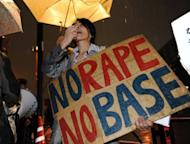 Civic group members protest over the alleged rape of a local woman by two US servicemen in Okinawa, in front of the prime minister's residence in Tokyo on October 17. US troops in Okinawa, southern Japan, have been banned from drinking off base, a US military statement said, following a spate of crimes