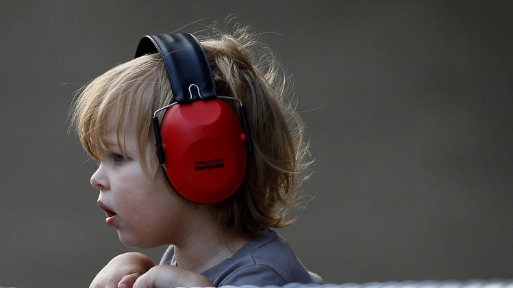 Lennon Roland, 2, watches cars zip by during an American Le Mans Series practice round for the IndyCar Baltimore Grand Prix auto race on Friday, Sept. 2, 2011, in Baltimore. (AP Photo/Patrick Semansky)