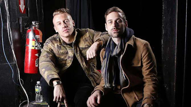 """FILE - This Nov. 20, 2012 file photo shows American musician Ben Haggerty, better known by his stage name Macklemore, and his producer Ryan Lewis at Irving Plaza in New York. """"Thrift Shop"""" by Macklemore & Ryan Lewis featuring Wanz, was the top streamed tracks on Spotify from Monday, Dec. 31, to Sunday, Jan. 6.  (Photo by Carlo Allegri/Invision/AP, file)"""