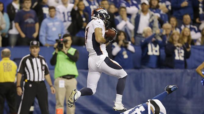 Denver Broncos wide receiver Eric Decker (87) makes a touchdown catch against Indianapolis Colts' Antoine Bethea (41) during the first half of an NFL football game, Sunday, Oct. 20, 2013, in Indianapolis