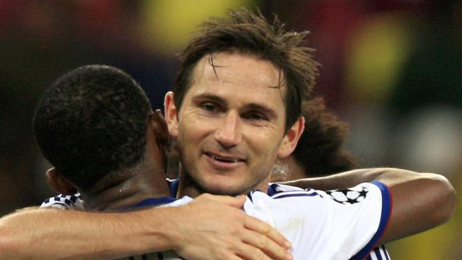 Chelsea's Lampard celebrates with his team mate Eto's after scoring a goal against Steaua Bucharest during their Champions League soccer match at the National Arena in Bucharest