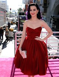 Katy Perry wears a red velvet Dolce & Gabanna gown that makes her purple hair pop at the premiere of 'Katy Perry: Part Of Me' in Hollywood on June 26, 2012 -- Getty Images