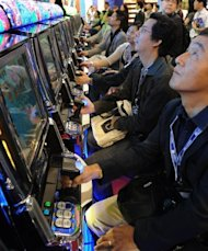 Visitors to Global Gaming Expo check out the latest gambling wares at a gaming exhibition in Macau, in 2011. Casino industry leaders have gathered in the world's gambling capital Macau once again, for the 2012 edition of Global Gaming Expo Asia, a three-day feast of gambling innovations at the glitzy Venetian hotel