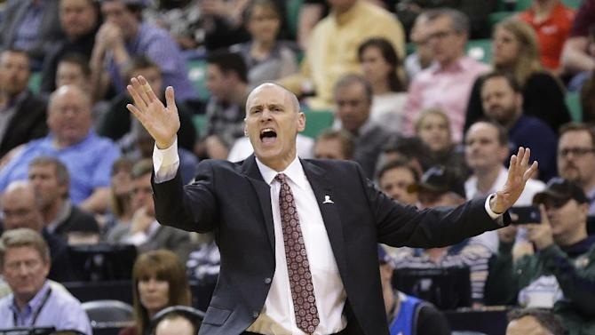 Dallas Mavericks head coach Rick Carlisle shouts to his team in the first quarter during an NBA basketball game against the Utah Jazz Wednesday, March 12, 2014, in Salt Lake City