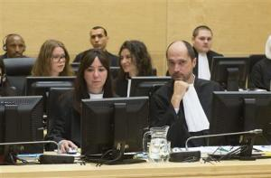 Defence Counsel Desalliers and Buteau look on during the case against Congolese militia leader Bosco Ntaganda at the International Criminal Court in The Hague