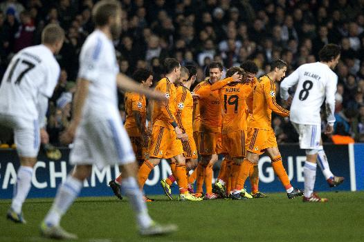 Real Madrid's Luka Modic centre  reacts with teammates, after scoring, during the Champions League, Group B, soccer match between FC Copenhagen and Real Madrid, at Parken in Copenhagen, Denmark, Tuesday Dec. 10, 2013
