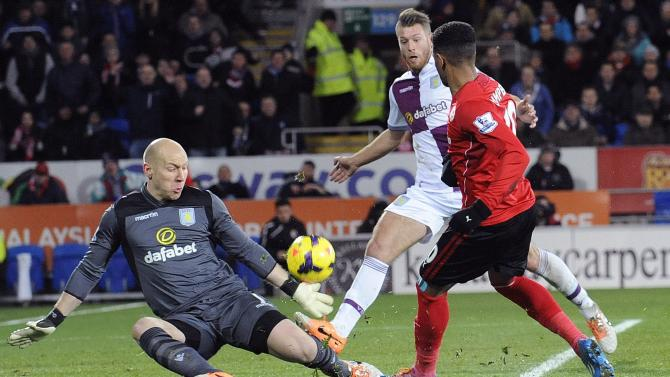 Aston Villa's Brad Guzan saves a shot from Cardiff City's Fraizer Campbell during their English Premier League soccer match at Cardiff City Stadium in Cardiff