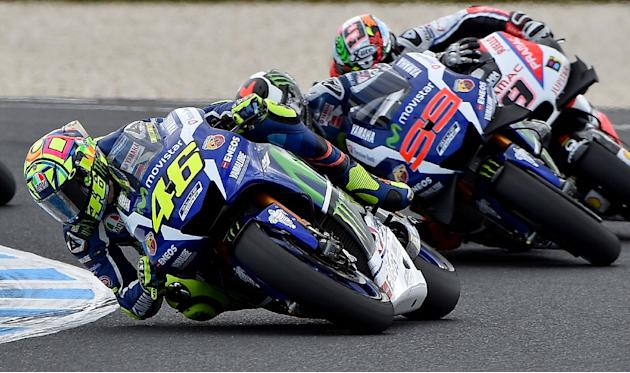 Movistar Yamaha MotoGP's Valentino Rossi (L) powers ahead of teammate Jorge Lorenzo (C) and OCTO Pramac Yakhnich's rider Danilo Petrucci during the Australian MotoGP