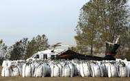A helicopter sits at a staging area behind bags of rocks near the Oroville Dam, Monday, Feb. 13, 2017, in Oroville, Calif. Officials from the California Department of Water Resources were considering using helicopters to drop loads of rock on the eroded spillway at Lake Oroville. (AP Photo/Rich Pedroncelli)