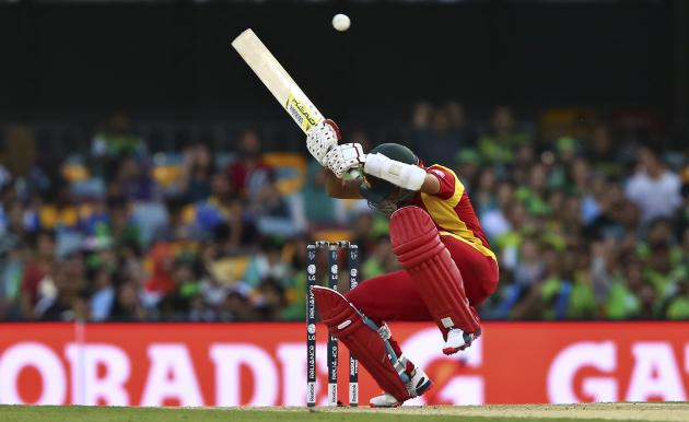 Zimbabwe's Sikandar Raza avoids a bouncer as he bats during the Pool B Cricket World Cup match against Pakistan in Brisbane, Australia, Sunday, March 1, 2015. (AP Photo/Tertius Pickard)