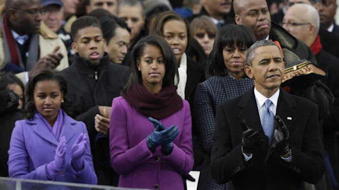 President Barack Obama applauds with his wife Michelle and daughters Sasha and Malia before his ceremonial swearing-in at the U.S. Capitol during the 57th Presidential Inauguration in Washington, Monday, Jan. 21, 2013. (AP Photo/Pablo Martinez Monsivais)
