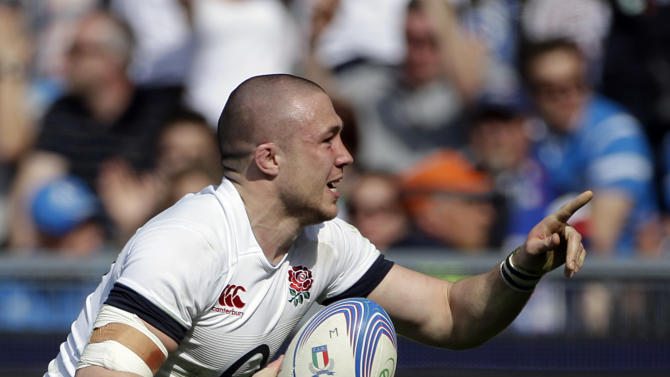 England's Mike Brown celebrates after scoring a try during the Six Nations Rugby Union match between Italy and England at Rome's Olympic stadium, Saturday, March 15, 2014. (AP Photo/Gregorio Borgia)