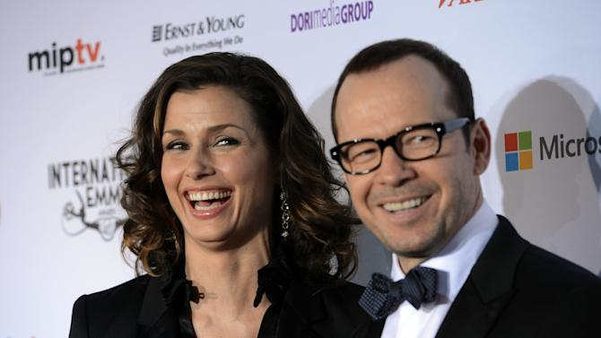 "Bridget Moynihan, left, and Donnie Wahlberg of the CBS series ""Blue Bloods,"" arrive for the 40th International Emmy Awards,  Monday, Nov. 19, 2012 in New York.  (AP Photo/Henny Ray Abrams)"
