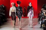 Models present creations by Portuguese designer Fatima Lopes during the Fall/Winter 2012-2013 ready-to-wear collection show in Paris