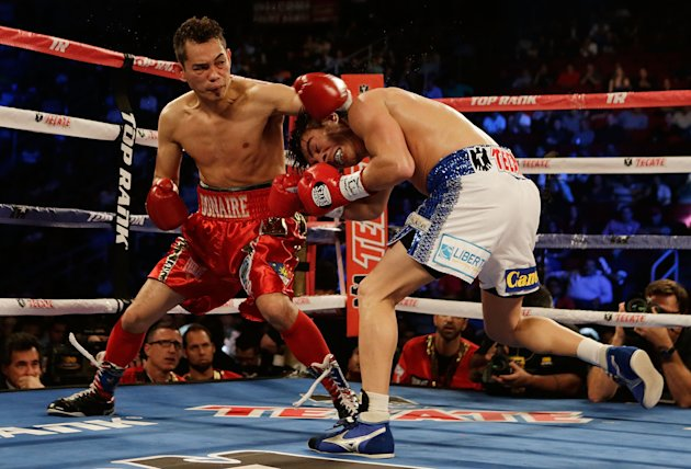HOUSTON, TX - DECEMBER 15: Nonito Donaire of the Philippines (L) hits Jorge Arce of Mexico during their WBO World Super Bantamweight bout at the Toyota Center on December 15, 2012 in Houston, Texas. (Photo by Scott Halleran/Getty Images)