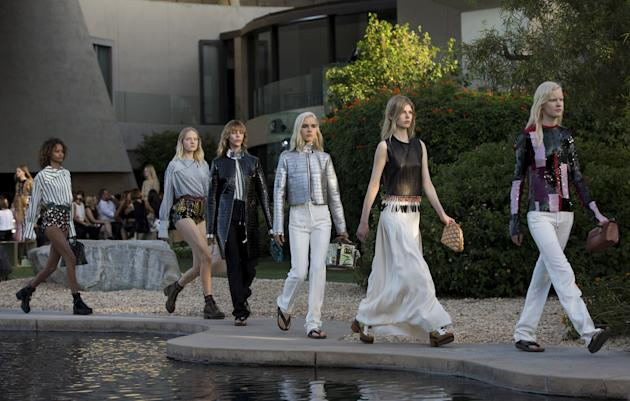 Models present designs from Louis Vuitton's women CRUISE 2016 collection during a fashion show at the estate of entertainer Bob Hope in Palm Springs