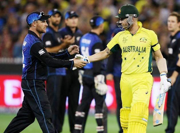 New Zealand captain Brendon McCullum, left, congratulates Australian captain Michael Clarke as he leaves the field after he was dismissed for 74 runs during the Cricket World Cup final in Melbourne, A
