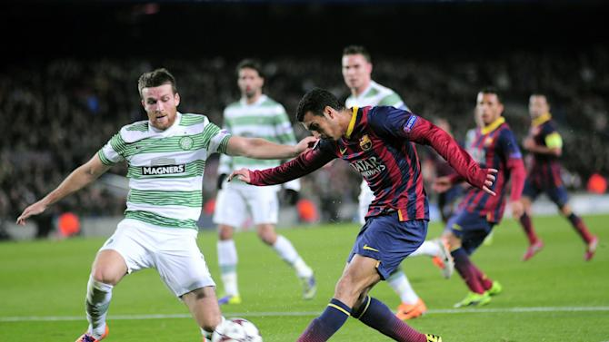 FC Barcelona's Pedro Rodriguez, right, duels for the ball against Celtic's Adam Matthews during a Champions League soccer match group H at the Camp Nou in Barcelona, Spain, Wednesday, Dec. 11, 2013