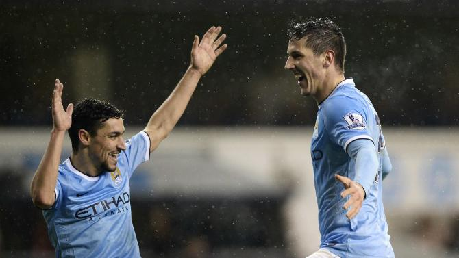 Manchester City's Jovetic celebrates with team mate Navas after scoring a goal against Tottenham Hotspur during their English Premier League soccer match at White Hart Lane in London