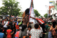 Juicy fruits: The gunungan buah pasar, which consists of about 350 kilograms of different type of fruits, was gone within minutes by the jostling crowd while being paraded. (