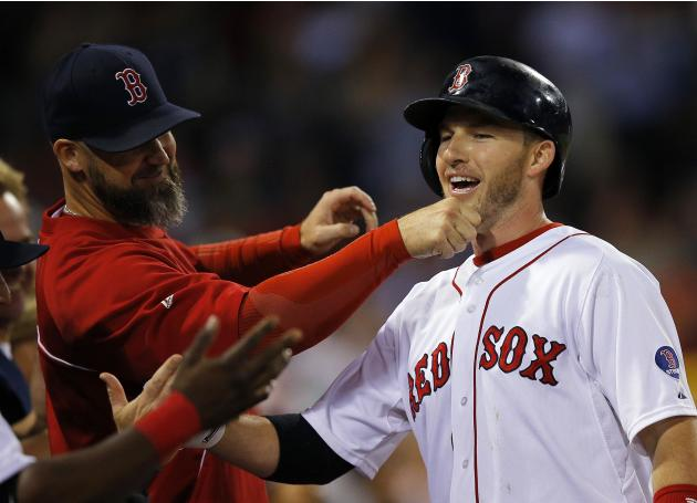 Red Sox's David Ross pulls on the beard of Drew after Drew hit a two-run, home run against the Orioles in the second inning of their MLB American League baseball game at Fenway Park in Boston