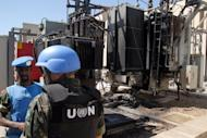 A picture from state-run Syrian Arab News Agency shows UN observers visiting a power transfer station in the Qabun district of Damascus. The Syrian army killed at least 26 civilians on Saturday, a watchdog said, as a global outcry mounted over yet another massacre in the country, but with Russia stressing that it will block any UN use of force against its ally
