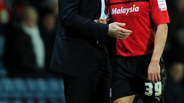 Malky Mackay, left, praised Craig Bellamy, right, for his role in the triumph over Blackburn