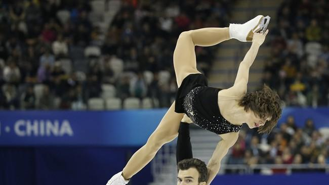 Meagan Duhamel and Eric Radford of Canada perform during the Pairs Free Skating in the ISU World Figure Skating Championship 2015 held at the Oriental Sports Center in Shanghai, China, Thursday, March 26, 2015. Duhamel and Radford finished in first place in the event. (AP Photo/Ng Han Guan)