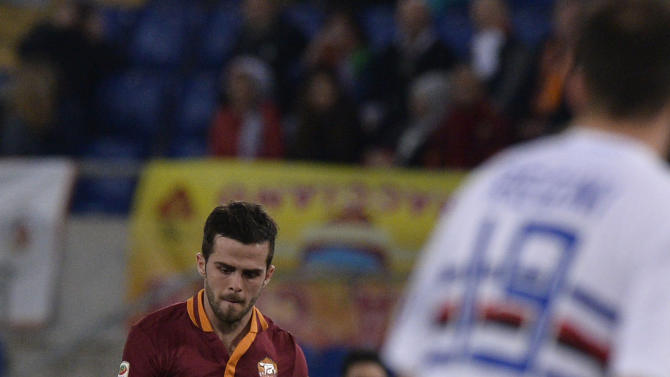 AS Roma midfielder Miralem Pjanic, of Bosnia, left, shoots to score on a free kick during a Serie A soccer match between AS Roma and Sampdoria, at Rome's Olympic stadium, Sunday, Feb. 16, 2014