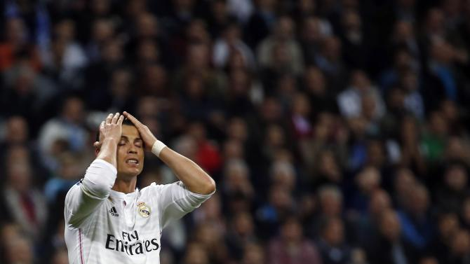 Real Madrid's Ronaldo reacts after a missed scoring opportunity against Villarreal during their Spanish first division soccer match at Santiago Bernabeu stadium in Madrid