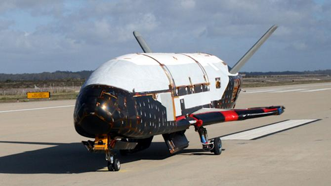 This undated file image provided by the U.S. Air Force shows the X-37B spacecraft. The unmanned Air Force space plane steered itself to a landing early Saturday, June 16, 2012, at a California military base, capping a 15-month clandestine mission. (AP Photo/U.S. Air Force, File)