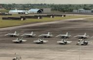 F-18 Hornet fighter jets are stationed at a former military base in the Philippines in 2007. The Philippines, which is now embroiled in a territorial dispute with China, is set to acquire new warplanes in two years to upgrade its poorly-equipped air force