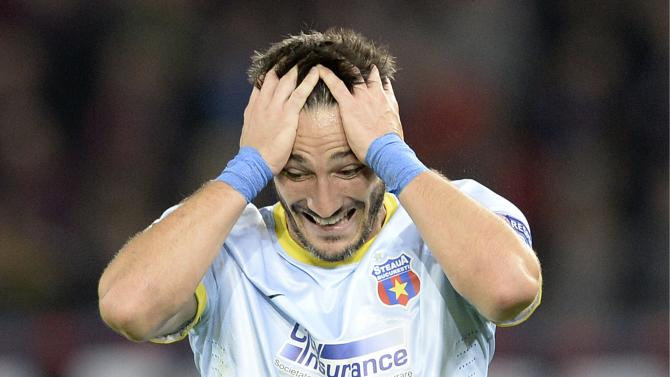 Steaua's Federico Piovaccari, reacts after scoring during a Champions League group E group stage match between Switzerland's FC Basel 1893 and Romania's FC Steaua Bucharest at the St. Jakob-Park stadium in Basel, Switzerland, Wednesday, Nov. 6, 2013