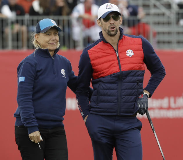 United States' Michael Phelps and Europe's Martina Narvratilova wait to tee off during the celebrity match at the Ryder Cup golf tournament Tuesday, Sept. 27, 2016, at Hazeltine National Golf